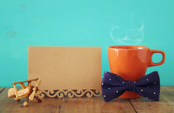 Cup of coffee with bow tie. Father& x27;s day concept Stock Image