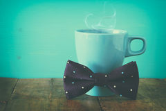 Cup of coffee with bow tie. Father& x27;s day concept Royalty Free Stock Images