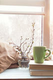 Cup of coffee, branch of cherry on windowsill Royalty Free Stock Photography