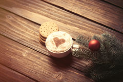 Cup of coffee and branch with christmas bubbles Stock Images