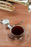 Cup of Coffee and Brass Wind Intrument Stock Images
