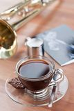 Cup of Coffee and Brass Wind Intrument Royalty Free Stock Photography