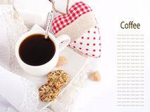 Cup of coffee, bread and red heart Stock Image