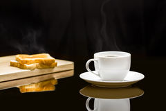 Cup of coffee and breads. Breakfast with coffee and breads Stock Image