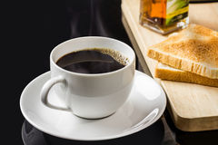 Cup of coffee and breads. Breakfast with coffee and breads Royalty Free Stock Image