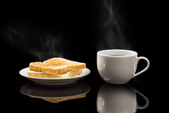 Cup of coffee and breads. Breakfast with coffee and breads Royalty Free Stock Images