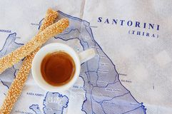 Cup of coffee and breadsticks on the map stock images