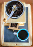 Cup of coffee, brewed with beans and a coffee grinder Royalty Free Stock Photos