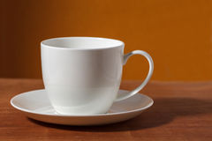 Cup of coffee. On brown background Stock Photos