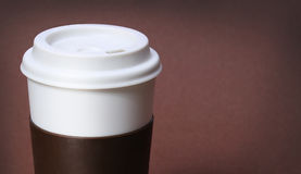 Cup of Coffee on brown background. Takeaway or Disposable Coffee Royalty Free Stock Photos