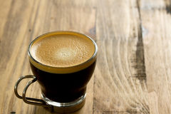 Cup of coffee on brown bakcground. Cup of coffee on brown wooden bakcground stock photos