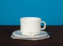 Cup of coffee on a brown cloth Stock Images