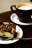 A cup of coffee in brown cup and cheese cake for breakfast Stock Photography