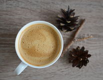 Cup of coffee and brown pine cones Stock Image