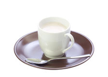A cup with coffee on a brown saucer Stock Image