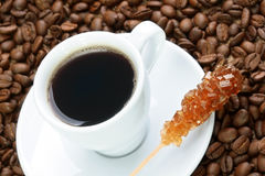 Cup of coffee with brown sugar Royalty Free Stock Images