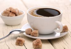 Cup of coffee with brown sugar. Stock Photography