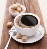 Cup of coffee with brown sugar. Stock Image
