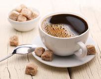 Cup of coffee with brown sugar. Royalty Free Stock Photo