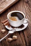 Cup of coffee with brown sugar. Royalty Free Stock Photography