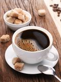 Cup of coffee with brown sugar. Royalty Free Stock Image