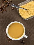 Cup of coffee and brown sugar Royalty Free Stock Photos
