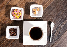 Cup of coffee with brown sugar, coffee beans and marshmallow bis Royalty Free Stock Image