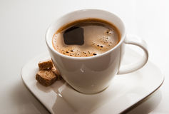 Cup of coffee and brown sugar Stock Photography