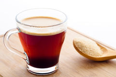 Cup of coffee with brown sugar Royalty Free Stock Photos