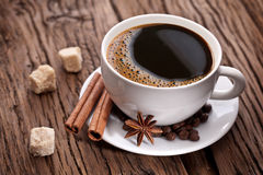 Cup of coffee with brown sugar. Stock Photos