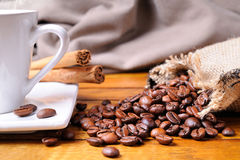 Cup of coffee on a brown wooden table front view Royalty Free Stock Photography