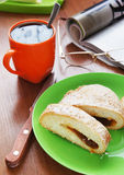 Cup of coffee and bun with jam for five-o-clock Stock Images