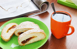 Cup of coffee and bun with jam for launch Royalty Free Stock Photos