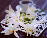 Cup of coffee and bunch of lilies Royalty Free Stock Photo
