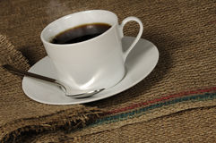 Cup of Coffee on Burlap Stock Images