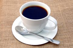 Cup of coffee on burlap. A shot of a cup of coffee on burlap Stock Photography