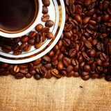 Cup of coffee on burlap Royalty Free Stock Images