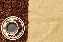 Cup of coffee on burlap. Background Stock Image