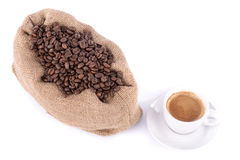 Cup of coffee with a burlap bag filled with coffee beans Stock Image