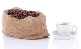 Cup of coffee with a burlap bag filled with coffee beans Stock Photography