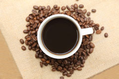 Cup of coffee on burlap sack Stock Photography