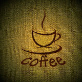 Cup of coffee. On burlap (sacking) texture Royalty Free Stock Images