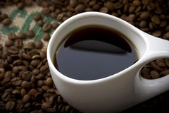 Cup of Coffee on Burlap Stock Photo