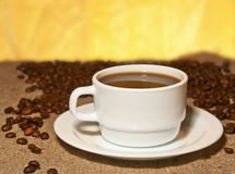 A cup of coffee on burlap on the table Stock Photography