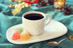 Cup of coffee, burning candle and colorful candy Royalty Free Stock Photography