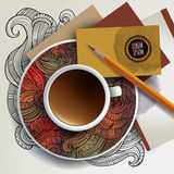 Cup of coffee, business cards and ornaments Stock Photo