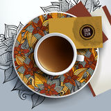 Cup of coffee, business cards and ornaments Stock Photos