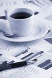 Cup coffee on business news Stock Image