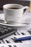 Cup coffee on  business news Royalty Free Stock Images