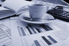 Cup coffee  business news Royalty Free Stock Images